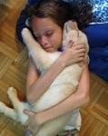 Бяло кученце с момиче