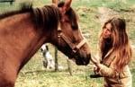 Бриджит Бардо със спасената кобила Дюшес