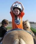 Терапия на деца с коне